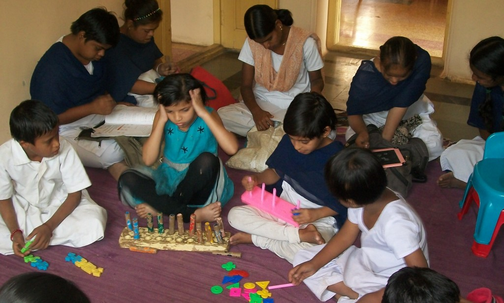 Mentally challenged children playing games